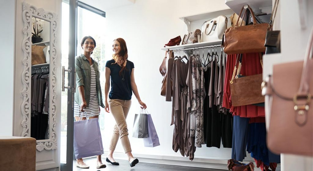 two women shopping inside a clothing boutique