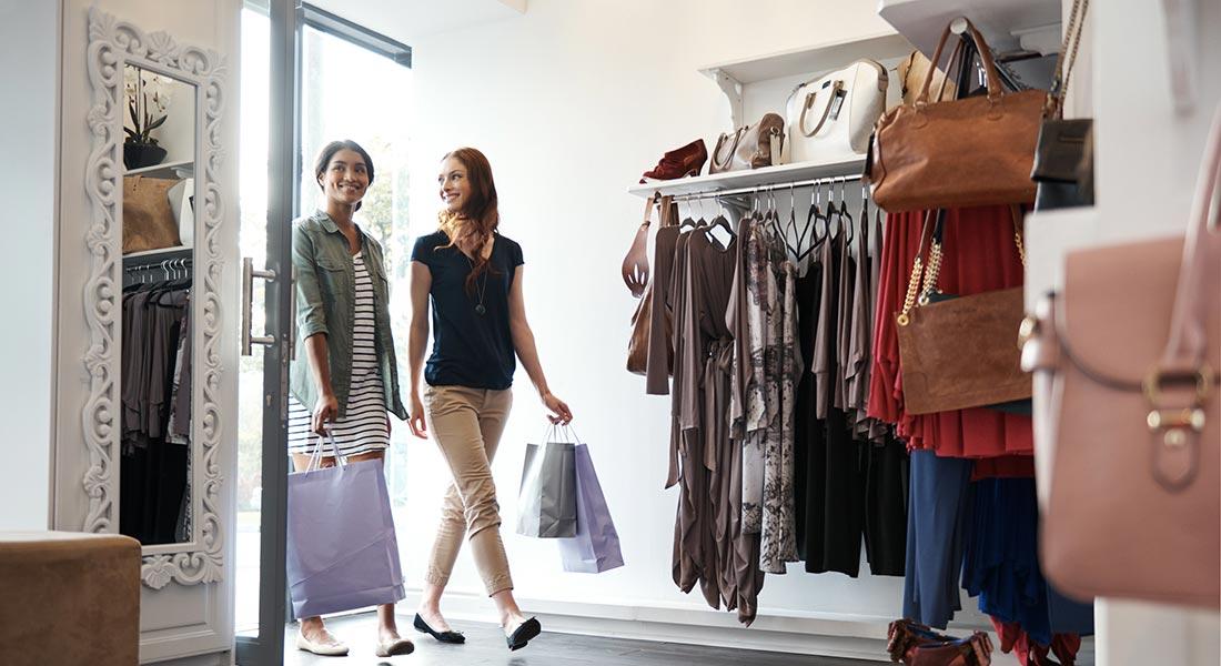 two women shopping inside a clothing boutique