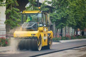 asphalt truck paving a street