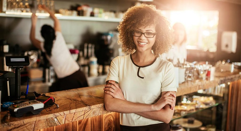smiling and confident minority-owned business owner
