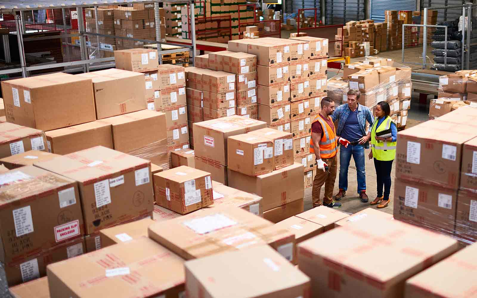warehouse workers discussing business