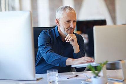 confident businessman using his computer
