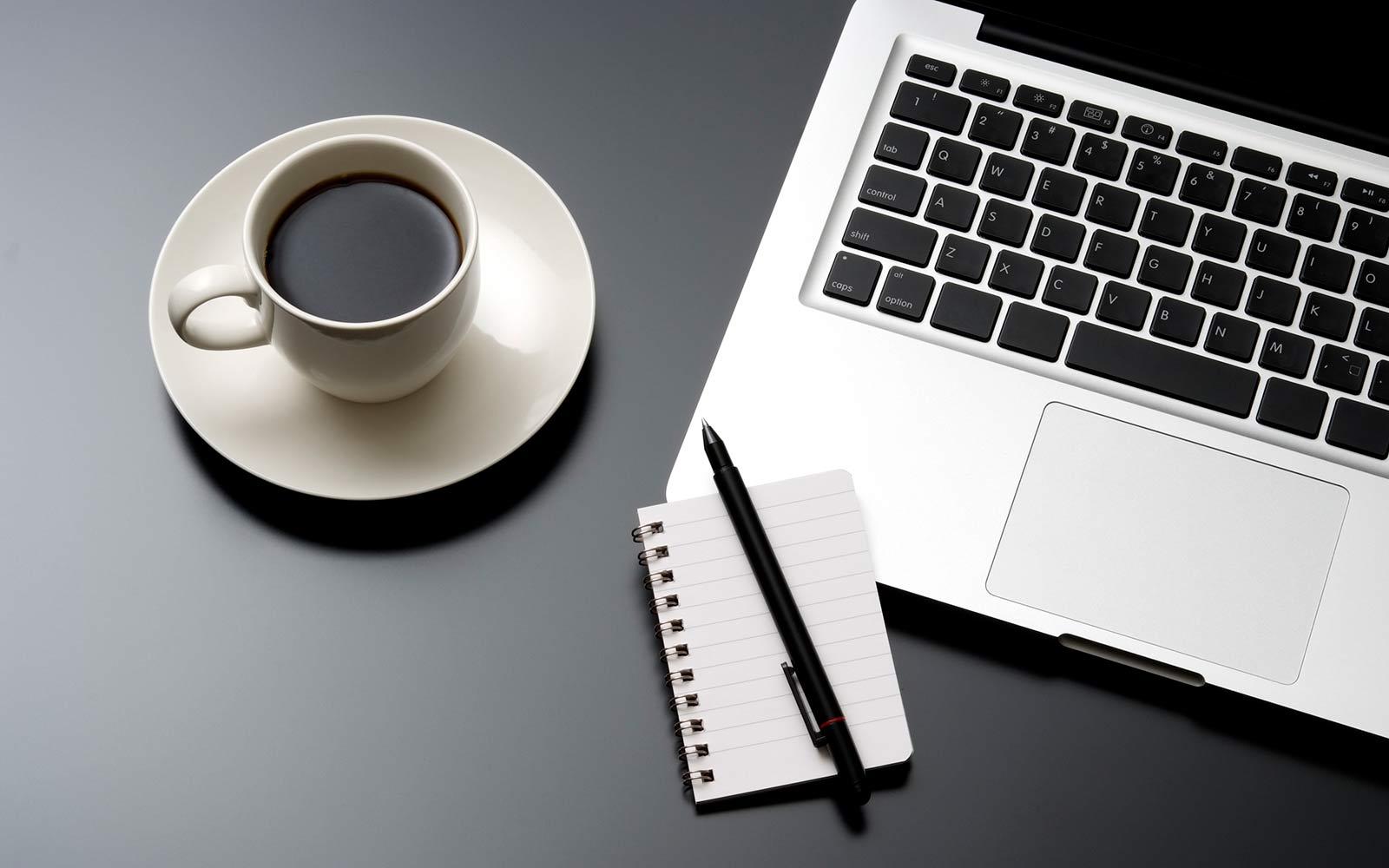 laptop computer and coffee mug