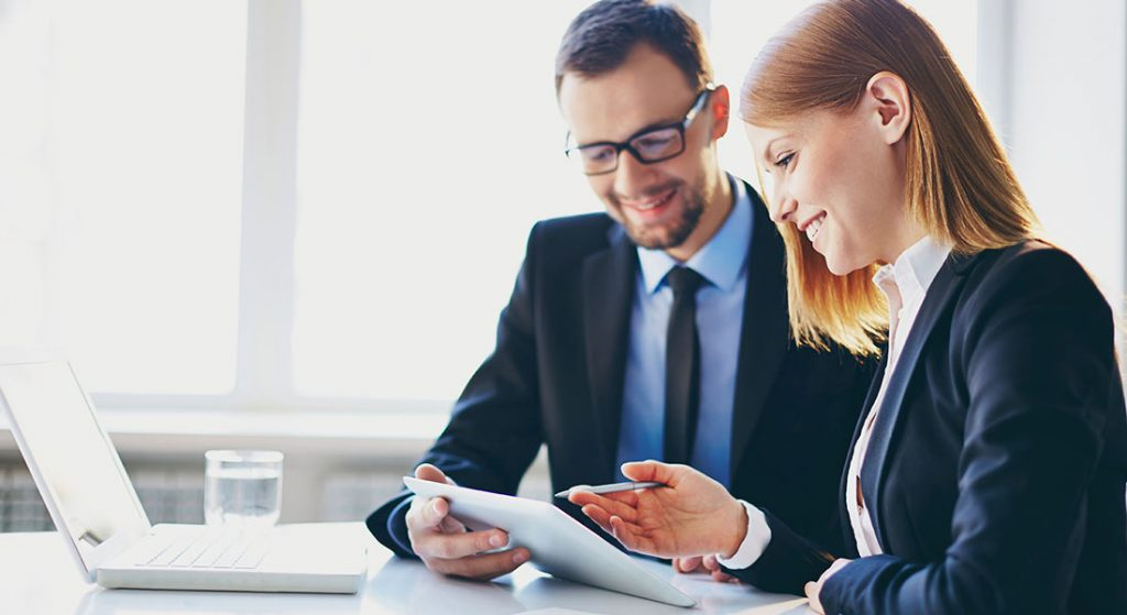 confident male and female business partners