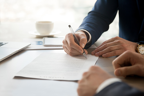 businessman signing lease contract