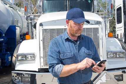 truck owner on mobile phone