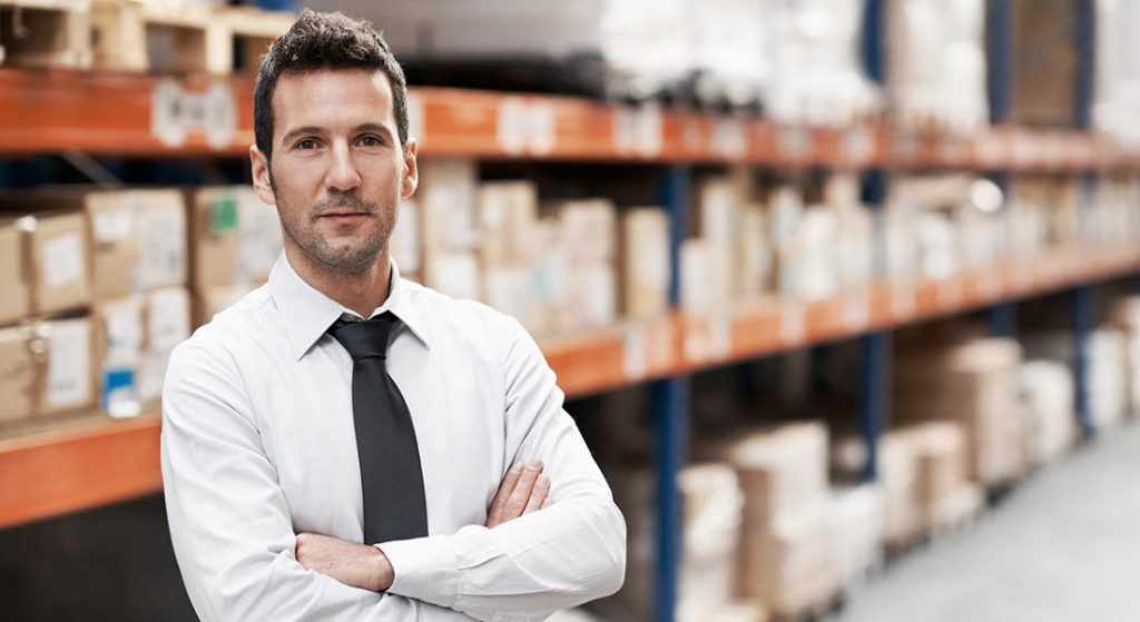 male business owner warehouse