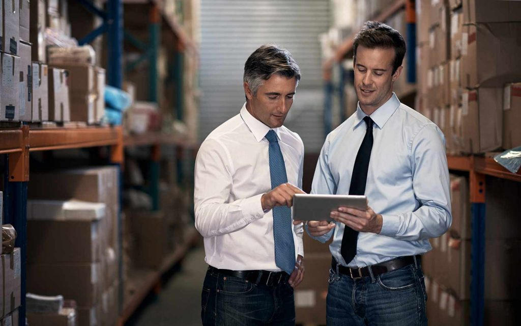two warehouse business owners discussing work