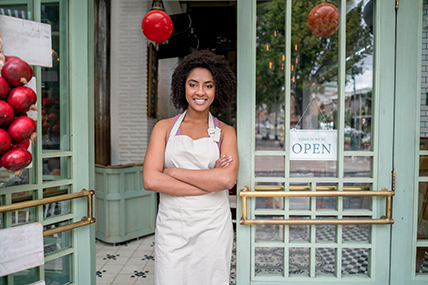 female small business owner storefront