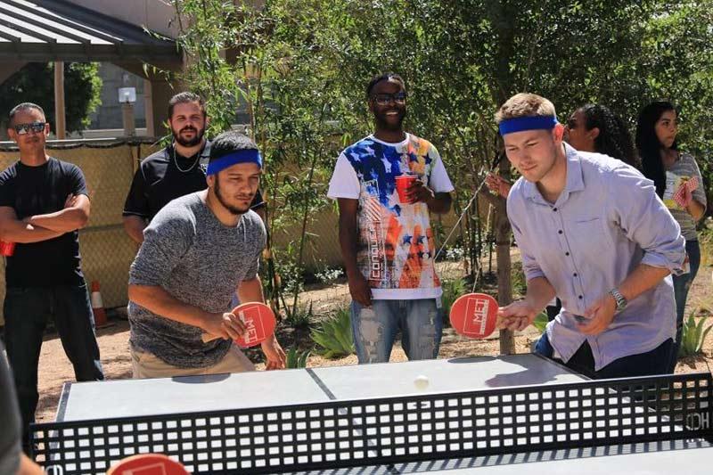 balboa capital employees playing ping pong
