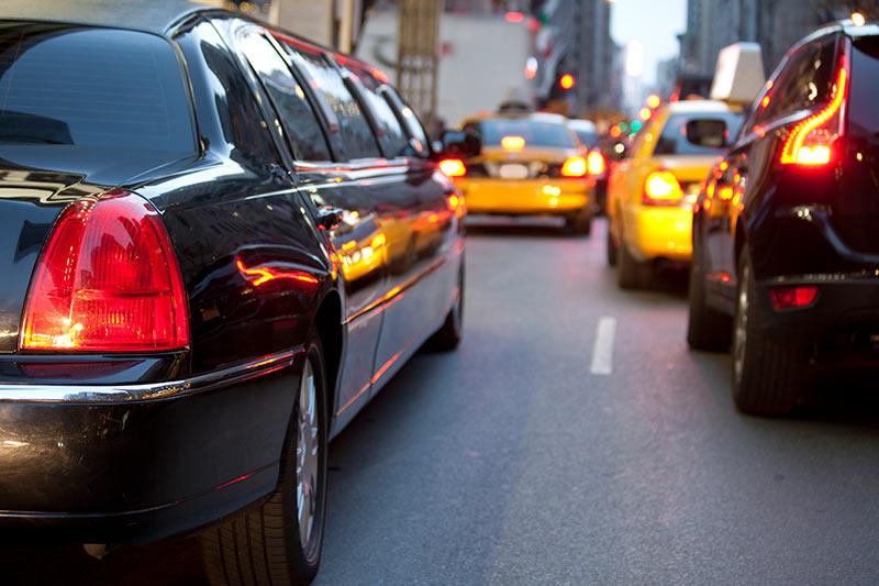 black limousine stuck in city traffic