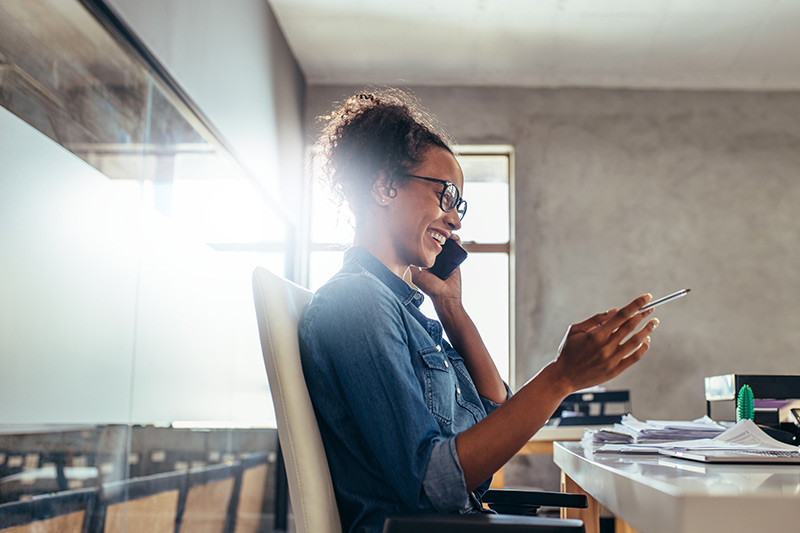 female entrepreneur on a phone call at her desk