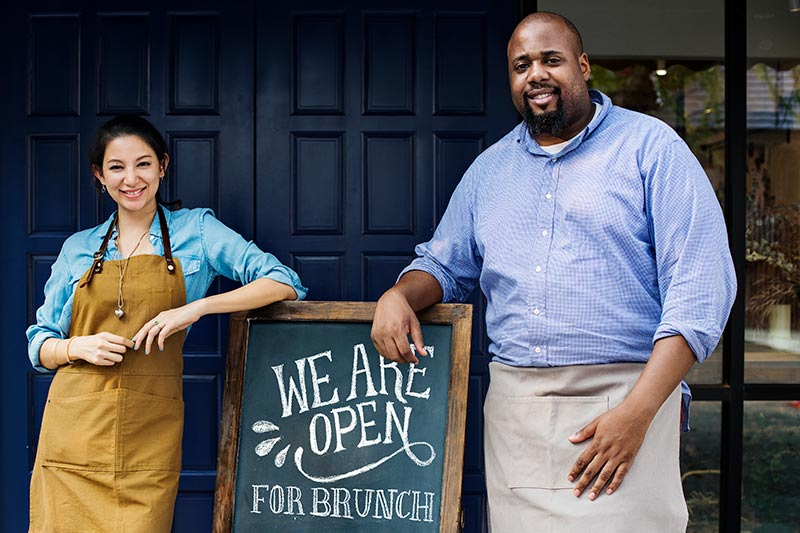two restaurant owners opening their doors