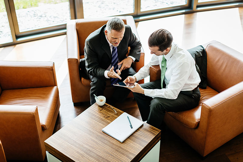 two male sales professionals conducting business