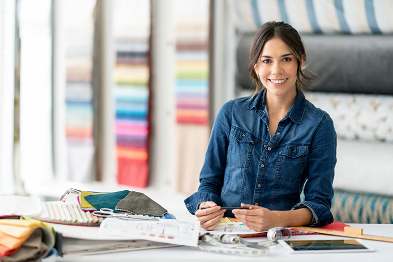 female upholstery business owner looking at fabric swatches