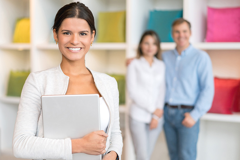 confident retail sales woman with two customers