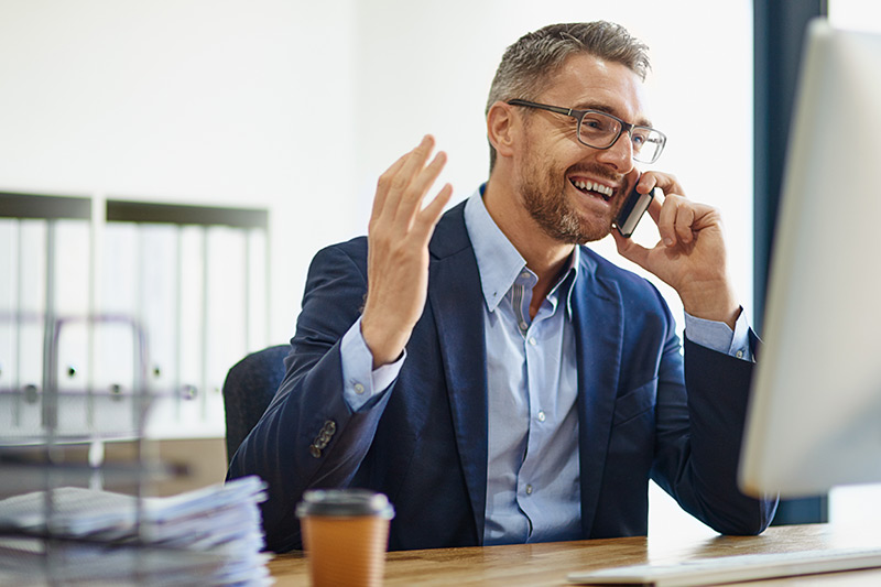 male business owner talking on his mobile phone