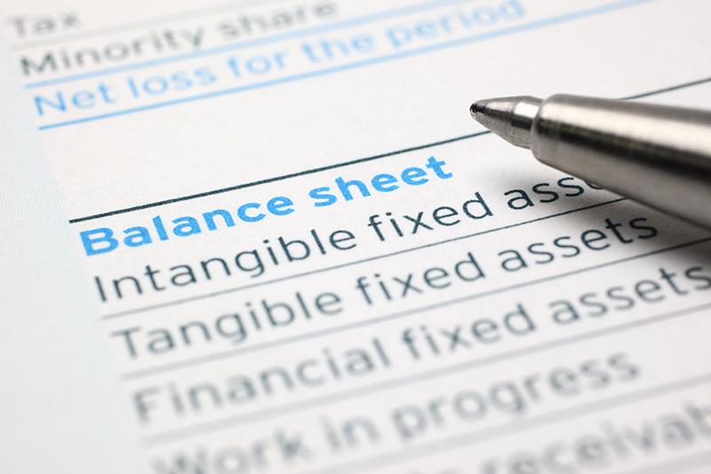 close up of a pen on a business balance sheet