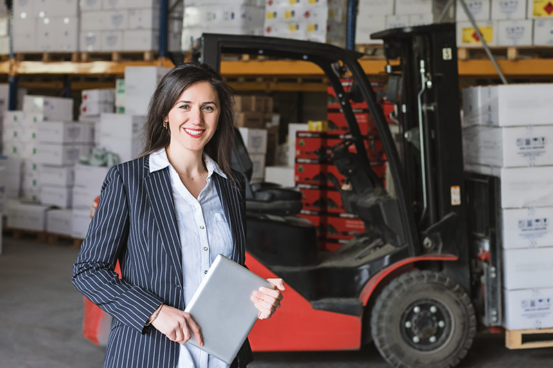 female employee near a red forklift
