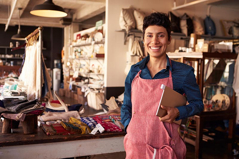 female small business owner standing in her store