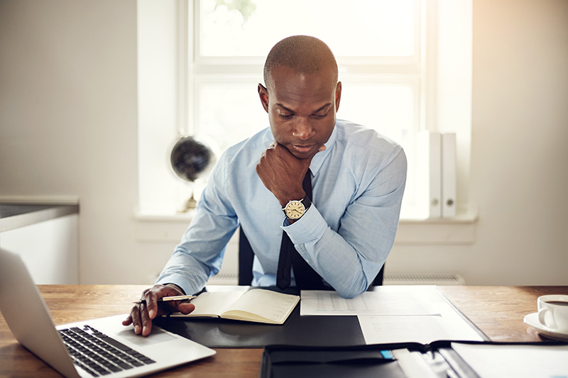 business owner doing financial work at his desk