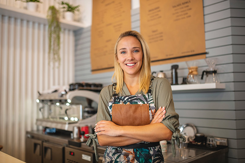 smiling female coffee shop owner