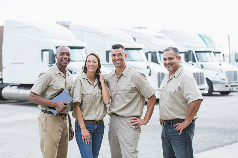 four truck owners standing in a truck lot