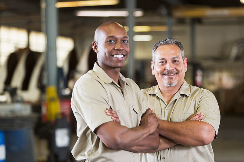 two auto shop business owners in the garage