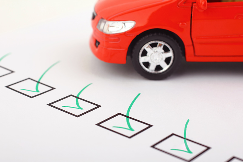 checkbox next to a red business vehicle