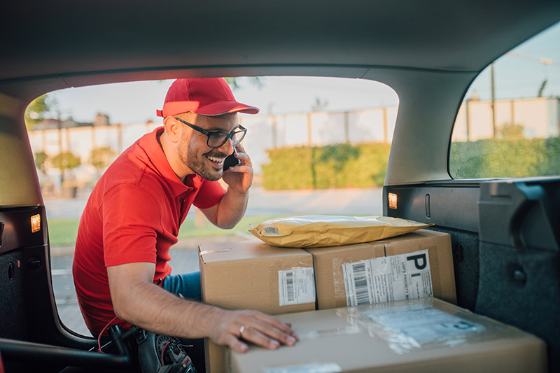 young male business owner delivering packages to his customers