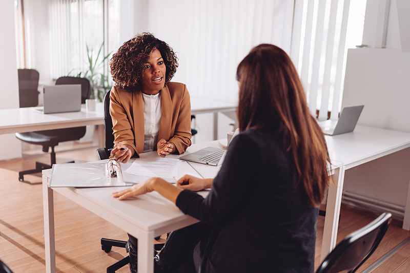 two female executives discussing a small business plan