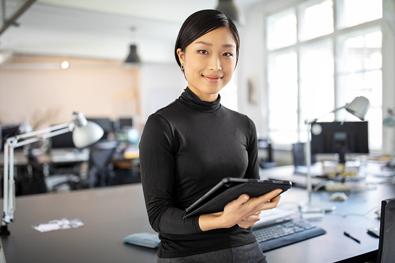 female asian american small business owner in her office